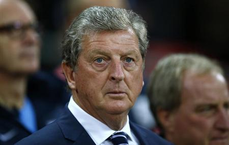 England's head coach Hodgson stands in dug out ahead of 2014 World Cup qualifying soccer match against Moldova in London