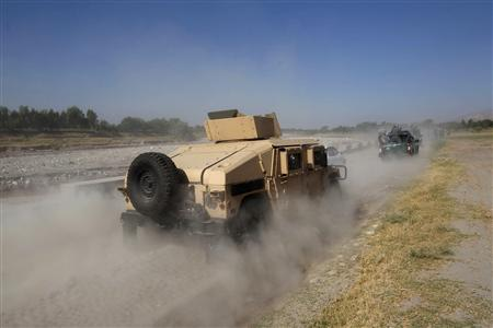 Afghan security forces arrive after an operation in the Sorkhrod district of Jalalabad province
