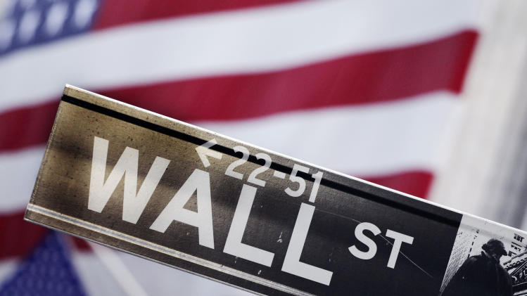 FILE - This Aug. 9, 2011 photo shows a Wall Street street sign near the New York Stock Exchange, in New York. (AP Photo/Mark Lennihan, File)