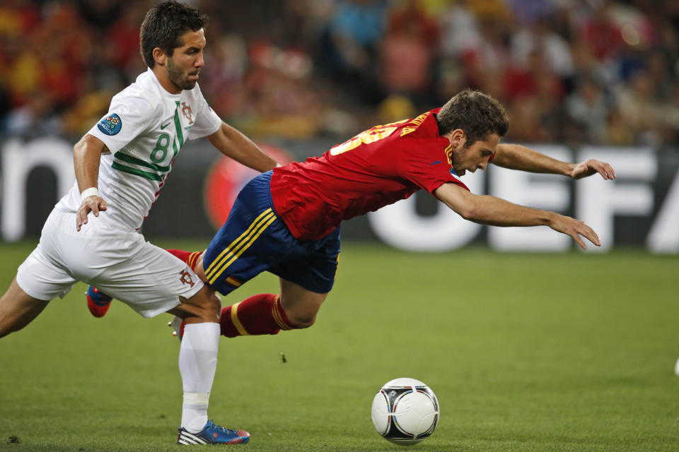 Portugal's Joao Moutinho, left, tackles Spain's Jordi Alba during the Euro 2012 soccer championship semifinal match between Spain and Portugal in Donetsk, Ukraine, Wednesday, June 27, 2012. (AP Photo/Armando Franca)