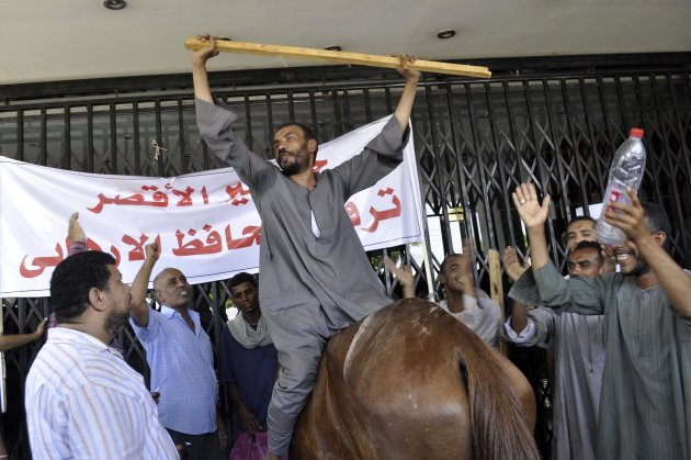 Protesters chant slogans in front of Luxor governorate building in Luxor