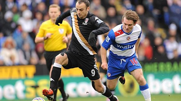 Fulham's Dimitar Berbatov (left) and Reading's Jay Tabb (right) battle for the ball