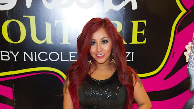 """Nicole """"Snooki"""" Polizzi hosts a meet and greet at a Perfumania for the release of her second fragrance, """"Snooki Couture"""" on Wednesday, January 9, 2013, in Las Vegas, NV (Photo by Al Powers/Powers Imagery/Invision/AP)"""