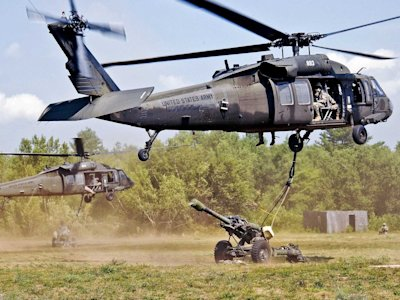 us army best photos 2012, black hawk airlifts a rocket launcher