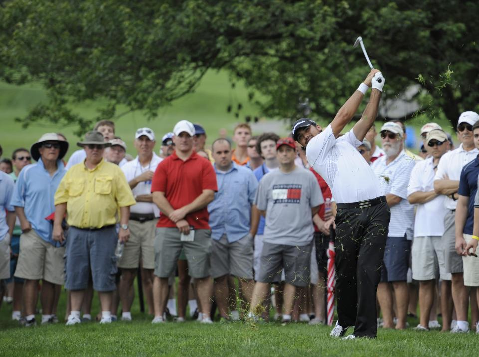 Jason Day, of Australia, hits from the rough on the third hole during the first round of the AT&T National golf tournament, Thursday, July 27, 2013, in Bethesda, Md. (AP Photo/Nick Wass)