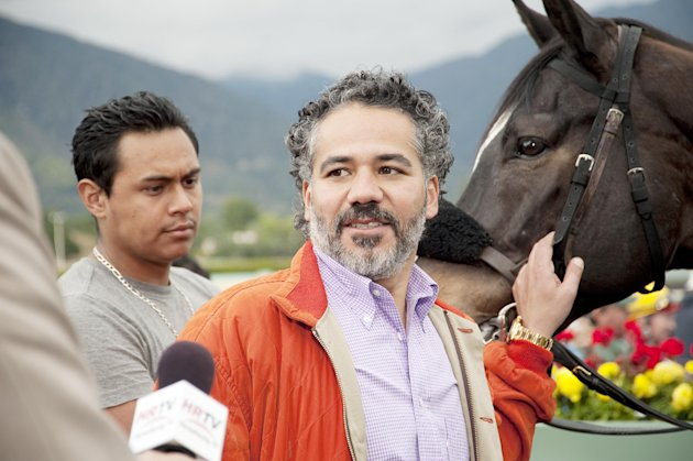 In this undated image provided by HBO, John Ortiz appears in a scene from the HBO original series &quot;Luck.&quot; The sport of horse racing is determined to endure the inevitable deaths of its injury-prone animals. But Hollywood has proved it lacks the stomach for it. The HBO TV channel ended the racing series &quot;Luck&quot; after three horses used in the realistic production were injured and euthanized over a period stretching from 2010 to last week. (AP Photo/HBO, Gusmano Cesaretti)