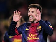 Barcelona&#39;s Lionel Messi celebrates after scoring a goal during their Spanish La Liga match against Espanyol, at the Camp Nou stadium in Barcelona, on January 6, 2013. Barcelona may be 11 points ahead of their nearest rivals, Atletico Madrid, but Messi, who this week won his fourth consecutive Ballon d&#39;Or, is keeping his feet on the ground regarding the title race