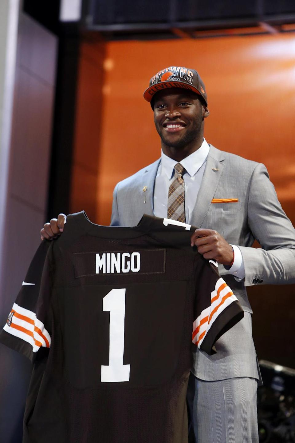 Defensive end Barkevious Ming from Louisiana State holds up the team jersey after being selected sixth overall by the Cleveland Browns in the first round of the NFL football draft, Thursday, April 25, 2013 at Radio City Music Hall in New York.  (AP Photo/Jason DeCrow)