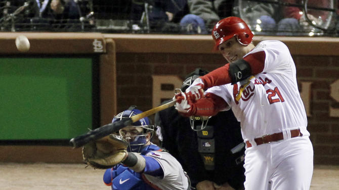 St. Louis Cardinals' Allen Craig hits a solo home run during the third inning of Game 7 of baseball's World Series against the Texas Rangers, Friday, Oct. 28, 2011, in St. Louis. (AP Photo/Jeff Roberson)