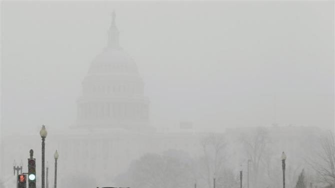 Snow sweeper attempts to clear street in front of US Capitol during blizzard in Washington