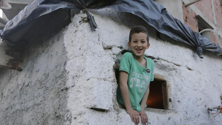 A boy looks from a window of his home in the shantytown of Citi Hofra