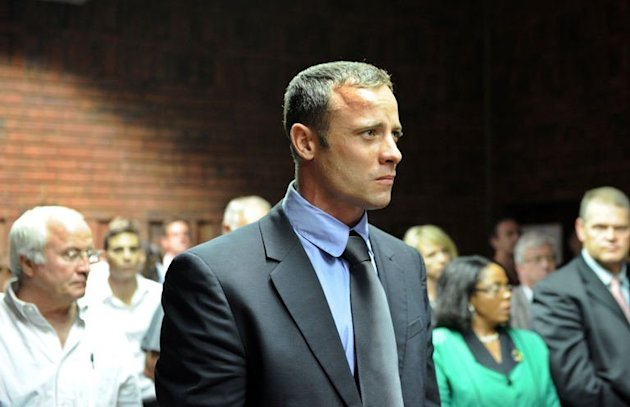 "South African Olympic sprinter Oscar Pistorius appears on February 19, 2013 at the Magistrate Court in Pretoria. ""Blade Runner"" Pistorius returned to court Wednesday to hear explosive allegations that he fought ""non-stop"" with his slain girlfriend Reeva Steenkamp on the night of her killing"
