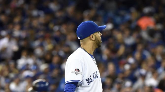 Texas Rangers' Rougned Odor, back left, rounds the bases on a solo home run off Toronto Blue Jays' pitcher David Price, foreground, during the top of the seventh inning of baseball Game 1 of the American League Division Series in Toronto on Thursday, Oct. 8, 2015. (Frank Gunn/The Canadian Press via AP) MANDATORY CREDIT