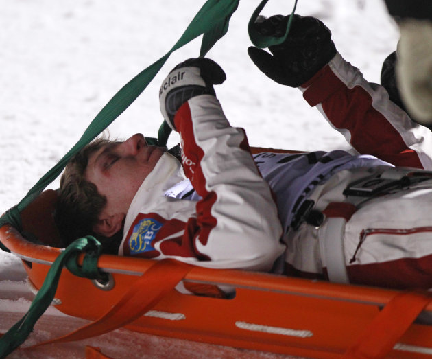 Canada's Travis Gerrits is taken off the course on a stretcher after crashing in the men's aerials World Cup freestyle skiing event in Lake Placid, N.Y., on Saturday, Jan. 21, 2012. (AP Photo/Mike Gro