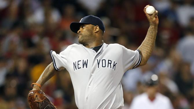 New York Yankees' CC Sabathia pitches in the first inning of a baseball game against the Boston Red Sox, Sunday, Aug. 18, 2013, in Boston. (AP Photo/Michael Dwyer)
