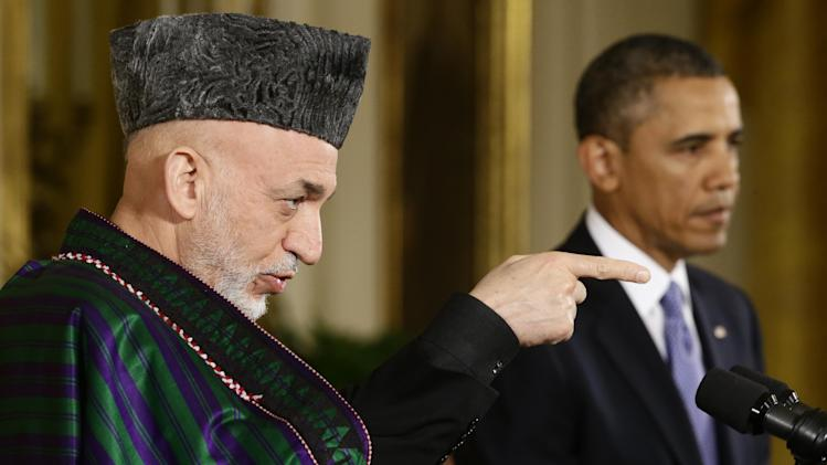 Afghan President Hamid Karzai takes questions from reporters during his joint news conference with President Barack Obama in the East Room at the White House in Washington, Friday, Jan. 11, 2013. (AP Photo/Charles Dharapak)