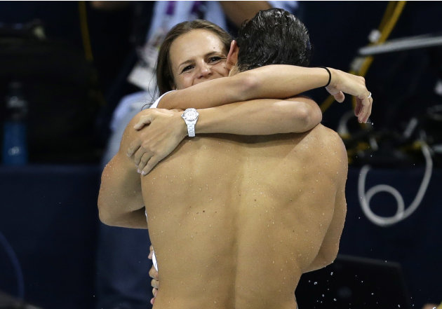 Laure Manaudou hugs her brother France's Florent Manaudou after he won in the men's 50m freestyle final during the London 2012 Olympic Games