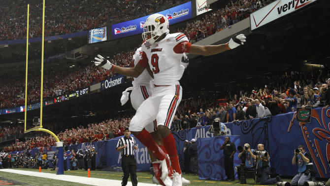 Louisville wide receiver DeVante Parker (9)celebrates with wide receiver Damian Copeland (7) after catching a touchdown pass in the first half of the Sugar Bowl NCAA college football game against Florida on Wednesday, Jan. 2, 2013, in New Orleans. (AP Photo/Butch Dill)