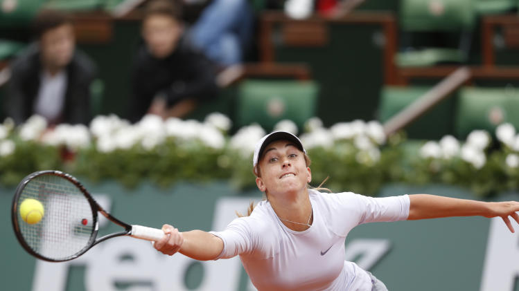 Croatia's Petra Martic returns the ball to Serbia's Ana Ivanovic during their first round match of the French Open tennis tournament at the Roland Garros stadium Sunday, May 26, 2013 in Paris. (AP Photo/Petr David Josek)