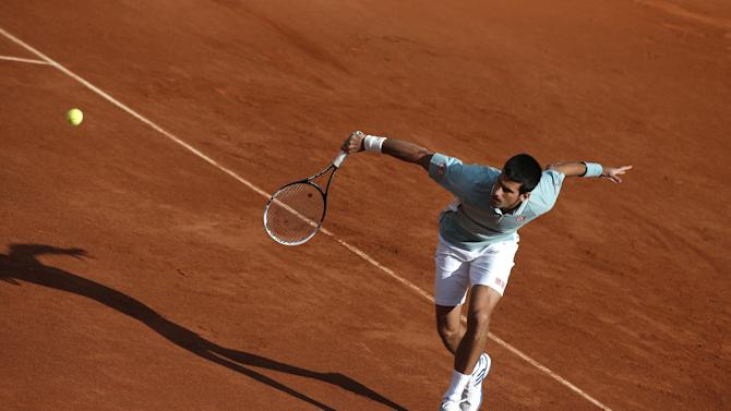 Serbia's Novak Djokovic returns against David Goffin of Belgium during their first round match at the French Open tennis tournament, at Roland Garros stadium in Paris, Tuesday, May 28, 2013. (AP Photo/Michel Spingler)