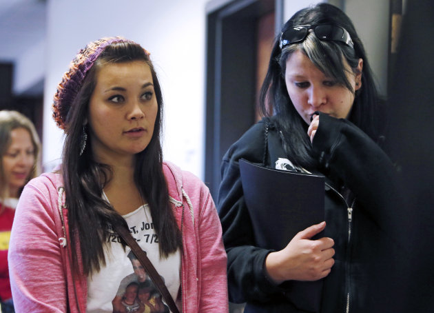 Chantel Blunk, left, leaves with a family member following a preliminary hearing for James Holmes at the courthouse in Centennial, Colo., on Monday, Jan. 7, 2013. Investigators say Holmes opened fire