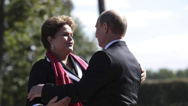 Russia's President Putin welcomes his Brazilian counterpart Rousseff before a BRICS leaders' meeting at the G20 Summit in Strelna near St. Petersburg
