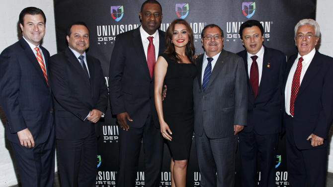 COMMERCIAL IMAGE - In this photograph taken by AP Images for Univision, Carlos Deschapelles, Senior Vice President, Sport Sales, Univision Deportes, Ariel Alvarado, Member of the Executive Committee and former President of the Panamanian Football Federation, Jeffrey Webb, Caribbean Football Union Representative to FIFA and President of Cayman Islands Soccer Federation, Antonietta Collins  Anchor, Univision Deportes Extra, Rafael Salguero, CONCACAF and FIFA executive committee, Alfredo Hawit, Acting President of CONCACAF; Senior Vice President of the CONCACAF Executive Committee and Secretary General of Honduran Soccer Federation, Justino Compeán,  Vice President of the Executive Committee of CONCACAF and President of Mexican Soccer Federation are seen at the Univision Deportes Network Launch Party on Thursday April 19, 2012 in New York.  (Brian Ach/AP Images for Univision)