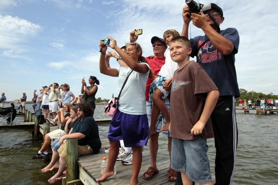 Spectators watch the final launch of space shuttle Atlantis in Titusville, Fla., Friday, July 8, 2011. (AP Photo/Gerry Broome)