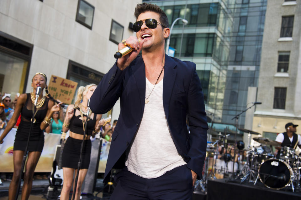 "FILE - In this July 30, 2013 file photo, Robin Thicke performs on NBC's ""Today"" show in New York. Thicke's single ""Blurred Lines,"" featuring T.I. and Pharrell is one of the top songs of the summer. (Photo by Charles Sykes/Invision/AP, File)"