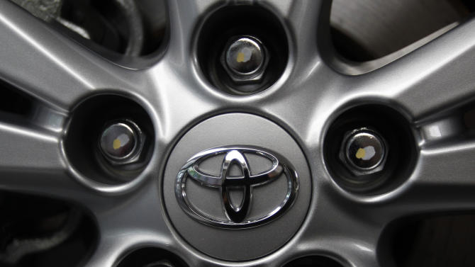 FILE - In this Aug. 2, 2011 file photo, the Toyota Motor Corp. logo is seen on a tire wheel of an Avensis sedan at Toyota's Tokyo headquarters. Toyota said Wednesday, July 25, 2012, it sold 4.97 million vehicles globally for the first six months of this year, a strong result that could see the Japanese automaker regain its crown as the world's top automaker from General Motors Co. (AP Photo/Shizuo Kambayashi, File)