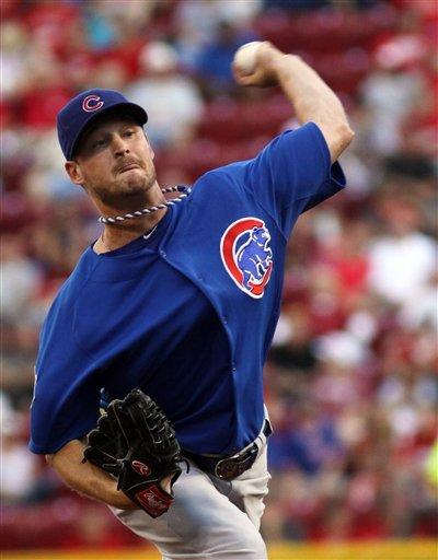 Reds hit 3 HRs in 7-3 win over Cubs