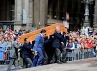 The coffin of cardinal Carlo Maria Martini is carried into Milan Cathedral. Thousands flocked to Milan Cathedral to pay their final respects to the cardinal who warned in an interview published posthumously that the Church was &quot;200 years behind&quot;