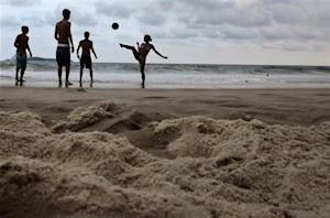 Residents play soccer at Ipanema beach ahead of the Confederations Cup in Rio de Janeiro