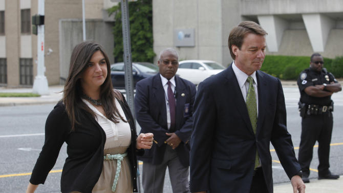 John Edwards, right, and his daughter Cate Edwards enter the federal courthouse for John Edwards' trial on charges of campaign corruption in Greensboro, N.C. on Tuesday, May 15, 2012. Edwards has pleaded not guilty to six counts related to campaign finance violations over nearly $1 million from two wealthy donors used to help hide the Democrat's pregnant mistress as he sought the White House in 2008.  (AP Photo/The News and Observer, Shawn Rocco)