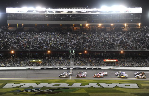 Trucks take the green flag to start the NASCAR Camping World Truck Series NextEra Energy Resources 250 race at the Daytona International Speedway in Daytona Beach