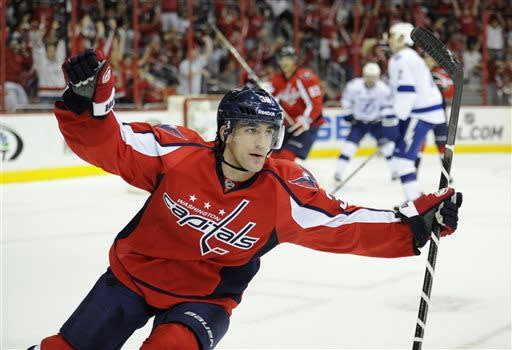 Caps blow 4-goal lead, top Lightning 6-5 in OT
