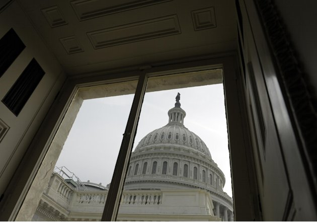FILE - This Friday, Dec. 28, 2012, file photo shows the Capitol dome on Capitol Hill in Washington. The brinkmanship in Washington over taxes and spending is likely to continue damaging the fragile ec