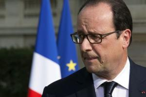 French President Francois Hollande delivers a speech outside the Foreign Affairs Ministry in Paris