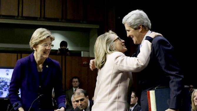 Senate Foreign Relations Chairman Sen. John Kerry, D-Mass., right, is greeted by Secretary of State Hillary Rodham Clinton on Capitol Hill in Washington, Thursday, Jan. 24, 2013, prior to testifying before his confirmation hearing before the committee to replace Clinton.  Sen. Elizabeth Warren, D-Mass. is at left. Kerry is likely to face friendly questioning on a smooth path to approval before the committee he has served on for 28 years and led for the past four.  (AP Photo/Pablo Martinez Monsivais)