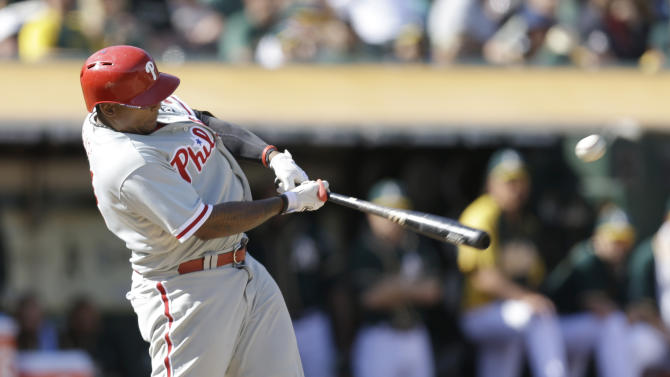 Philadelphia Phillies' Marlon Byrd connects for an RBI single off Oakland Athletics Ryan Cook in the eighth inning of a baseball game Saturday, Sept. 20, 2014, in Oakland, Calif. (AP Photo/Ben Margot)