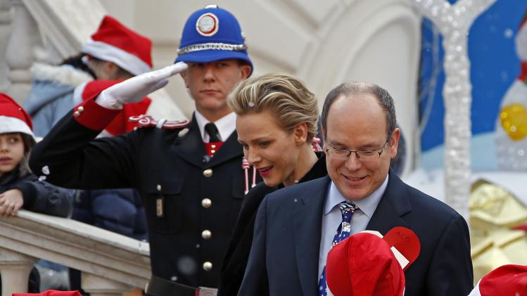 Prince Albert II of Monaco and his wife Princess Charlene attend the traditional Christmas tree ceremony at the Monaco Palace in Monaco
