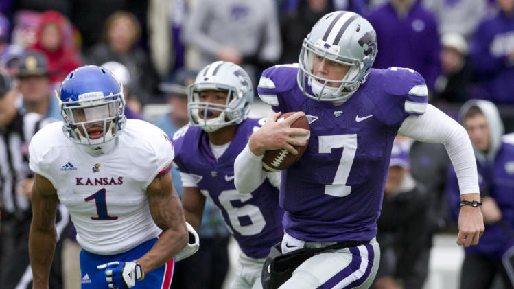 Kansas State quarterback Collin Klein (7) runs for a touchdown past Kansas safety Lubbock Smith (1) during the second half of an NCAA college football game in Manhattan, Kan., Saturday, Oct. 6, 2012. (AP Photo/Orlin Wagner)