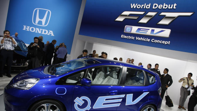 FILE- In this Nov. 17, 2010, file photo, Honda introduces its new FIT EV Electric Vehicle Concept car at the LA Auto Show Wednesday, in Los Angeles. Auto companies in the U.S. are lowering lease prices for electric cars as they try to jump-start slow sales in a competitive market. ( AP Photo/Damian Dovarganes)