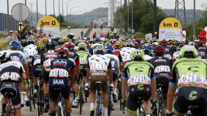 The pack of riders cycles during the 4th stage of the 102nd Tour de France cycling race from Seraing to Cambrai