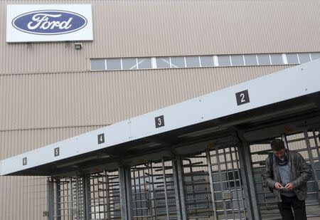 A worker leaves the factory for one of the final shifts at the Ford assembly plant in Genk