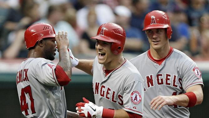 FILE - This July 3, 2012 file photo shows Los Angeles Angels' Mike Trout, center, celebrating with Howard Kendrick (47) and John Hester after Trout's three-run home run off Cleveland Indians starting pitcher Zach McAllister in the fifth inning of a baseball game in Cleveland. Trout is favored to win AL Rookie of the Year, Monday, Nov. 12, 2012. (AP Photo/Mark Duncan, File)