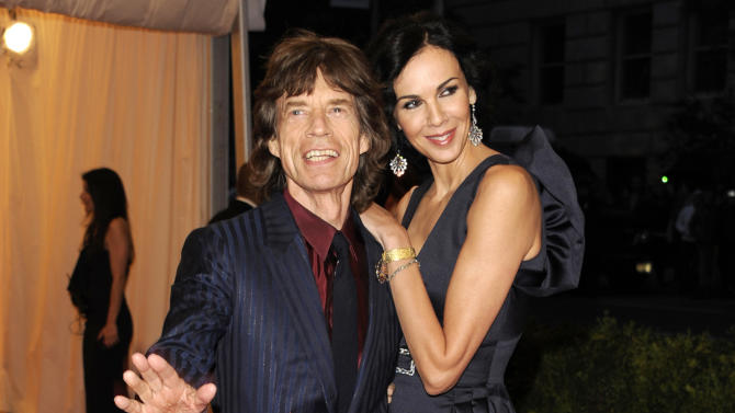 FILE - This May 7, 2012 file photo shows singer Mick Jagger, left, and L'Wren Scott at the Metropolitan Museum of Art Costume Institute gala benefit, celebrating Elsa Schiaparelli and Miuccia Prada, in New York. Scott, a fashion designer, was found dead Monday, March 17, 2014, in Manhattan of a possible suicide. (AP Photo/Evan Agostini, File)