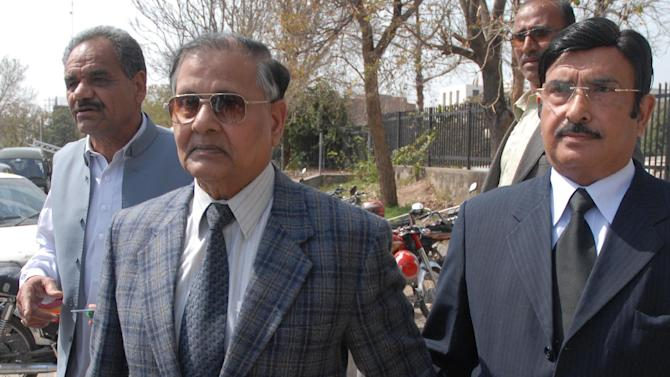 Former Pakistan army chief, retired General Mirza Aslam Beg, center, leaves the Supreme Court after hearing of the Mehran Bank scandal in Islamabad, Pakistan on Friday, March 9, 2012. Pakistan's powerful military establishment is under rare scrutiny from the country's top court, which after a gap of 16 years has opened an investigation into allegations it funneled money to politicians in the 1990's to influence elections. (AP Photo/B.K. Bangash)