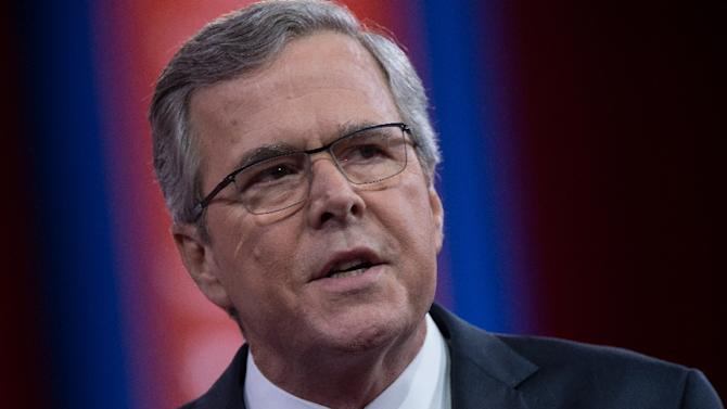 Republican 2016 presidential hopeful Jeb Bush (pictured) stepped into a heated debate about funding for women's health and abortion, offering a critique that earned a swift rebuke by Democratic rival Hillary Clinton