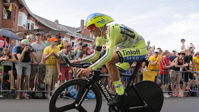 Spain's Alberto Contador strains during the first stage of the Tour de France cycling race, an individual time trial over 13.8 kilometers (8.57 miles), with start and Finish in Utrecht, Netherlands, Saturday, July 4, 2015. (AP Photo/Christophe Ena)